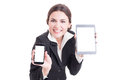 Beautiful young sales female showing modern technology devices with blank white screen or display ready for advertising Stock Photo