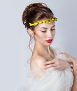 Beautiful young sexy elegant woman with red lips, beautiful hair with a wreath of yellow roses on the head with bared shoulders Royalty Free Stock Photo