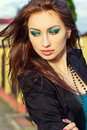 Beautiful young sexy girl with big lips with bright makeup walking the streets of the city Royalty Free Stock Images