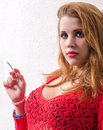 Beautiful young sexy girl smoking cigarette Stock Image