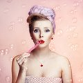 Beautiful young sexy pin up girl with surprised expression on pink background Stock Photos