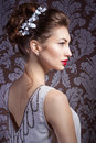 Beautiful young sexy sweet girl with large red lips in wedding white wreath on the head with beautiful wedding hairstyle Royalty Free Stock Photo