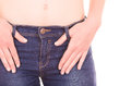 Beautiful young slim topless woman wearing jeans Royalty Free Stock Photo