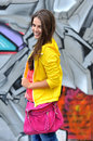Beautiful young smiling girl in bright clothes outdoors Royalty Free Stock Image