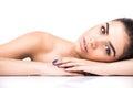 Beautiful young smiling latina lying on the white. Skin, cosmetology. Royalty Free Stock Photo