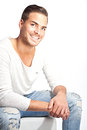 Beautiful young smiling man against white backgrou portrait of a background Stock Photography