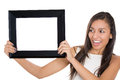 Beautiful young smiling woman holding a blank picture frame close up of isolated on white background Royalty Free Stock Images