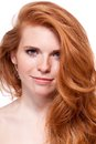 Beautiful young smiling woman with red hair and freckles isolated on white portrait Royalty Free Stock Photo