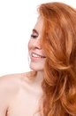 Beautiful young smiling woman with red hair and freckles isolated on white portrait Royalty Free Stock Photography