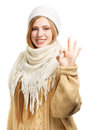 Beautiful young smiling woman in winter clothing with okay sign standing isolated on white background Stock Image