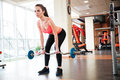 Beautiful young sportswoman doing exercises with barbell in gym Royalty Free Stock Photo