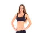 Beautiful young sporty muscular woman isolated against white background Stock Photography