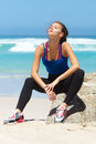 Beautiful young sporty woman at the beach Royalty Free Stock Photo