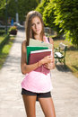 Beautiful young student girl outdoors. Royalty Free Stock Image