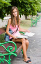 Beautiful young student girl studying outdoors. Stock Photo