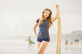 Beautiful young surfer girl stays on the beach at sunset light with yellow surfboard healthy lifestyle leisure travel holiday and Stock Images