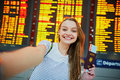 Beautiful young tourist girl in international airport Royalty Free Stock Photo
