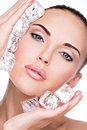 Beautiful young woman applies the ice to face skin care concept Royalty Free Stock Image