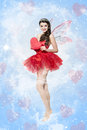 Beautiful young woman as love fairy with heart romantic portrait Stock Photography