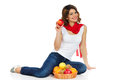 Beautiful young woman with basket of fruit Stock Image