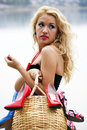 Beautiful young woman with a basket full  of shoes Royalty Free Stock Photo