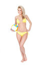 Beautiful young woman in bikini playing volleyball Royalty Free Stock Photography