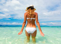 Beautiful young woman in bikini on the sunny tropical beach  Royalty Free Stock Images