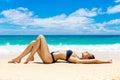 Beautiful young woman in bikini on a tropical beach Royalty Free Stock Photo