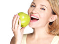 Beautiful young woman biting the biting a fresh ripe apple on white background Stock Images