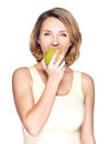 Beautiful young woman biting the biting a fresh ripe apple on white background Royalty Free Stock Photos