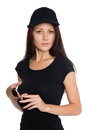 Beautiful young woman in a black baseball cap Royalty Free Stock Photo