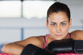 Beautiful young woman in black boxing gloves close up portrait of a Royalty Free Stock Images