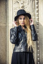 Beautiful young woman in black hat Royalty Free Stock Photo