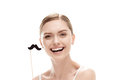 Beautiful young woman with black mustaches on stick