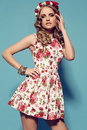 Beautiful young woman with blond curly hair wears elegant clothes and bijou fashion studio photo of flower s headband Royalty Free Stock Photography