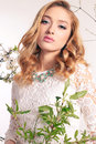 Beautiful young woman with blond curly hair, wears elegant clothes and bijou, Royalty Free Stock Photo
