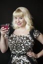 Beautiful young woman with blond hair drinking a pink martini portrait of drinkiing Royalty Free Stock Images