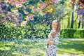 Beautiful young woman in blooming spring park Royalty Free Stock Photo