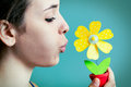 Beautiful young woman blowing on artificial daisy portrait of Royalty Free Stock Photos