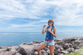 Beautiful young woman blowing bubble in outdoor, nature, near the ocean. Tropical magic island Bali, Indonesia. Royalty Free Stock Photo