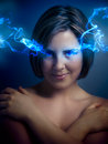 Beautiful young woman with blue eyes, blue smoke coming out of h Stock Images