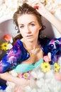 Beautiful lady taking a bath with flower peta Royalty Free Stock Photo