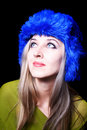 Beautiful young woman in blue winter hat Royalty Free Stock Images