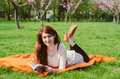 Beautiful young woman with book in the park Stock Photos