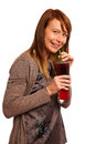 Beautiful young woman in brown dress with a glass of ice tea isolated over white background Stock Photos