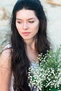 Beautiful young woman with bunch of wildflowers Royalty Free Stock Photo