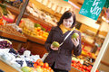 Beautiful young woman buying mangoes Royalty Free Stock Photography