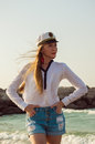 Beautiful young woman in a captain hat at the beach Royalty Free Stock Photo