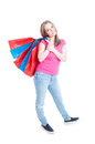Beautiful young woman carrying paper bags in her back Royalty Free Stock Photo