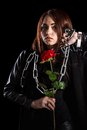 Beautiful young woman with chains and a red rose Royalty Free Stock Photo